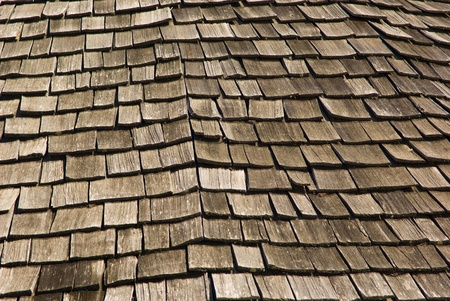pitched roof: roof; tiles; trullo; pitched; tile; home; house; sky; blue; mountain; village; typical; characteristic; background; wood; brick; dwelling; building; construction; covered; open air; open; air Stock Photo