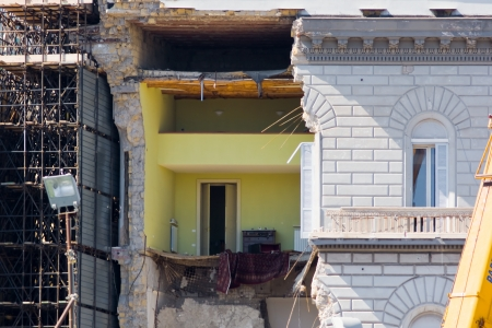 infiltration: Facade and floor of a building collapsed Stock Photo