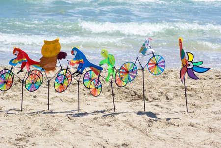 pinwheels: Pinwheels on the beach Stock Photo