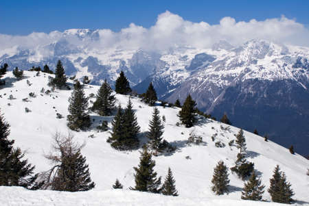 ski runs: View of an alpine winter landscape from the top of a mountain