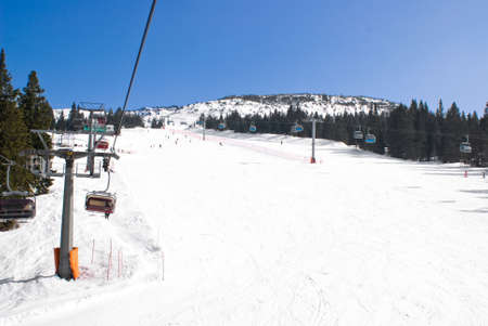 chair on the lift: View of an alpine ski run by the chair lift