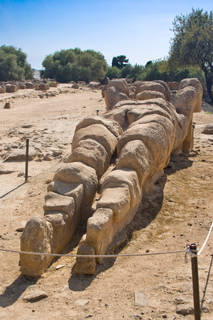 telamon: Remains of a Telamon in the Olympeon field, Valley of the Temples in Agrigento, Italy Stock Photo