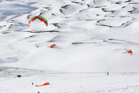 ski runs: Roccaraso, Italy - January 31, 2016: Snowkiter in action at world championship