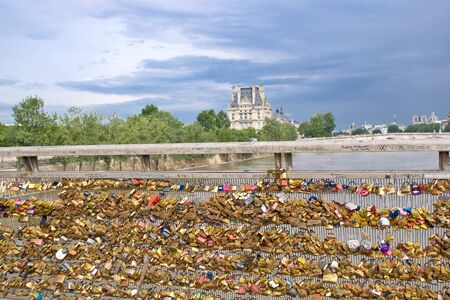 padlocks: Lovers padlocks on Passerelle Solferino in Paris