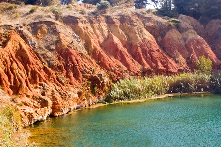 Little lake near a quarry of bauxite, Apulia in Italy