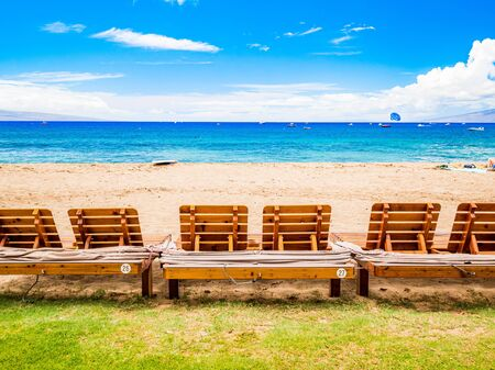 Beach sunbed on Kaanapali Beach, Maui, Hawaii. With three miles of white sand and crystal clear water, no wonder why Kaanapali Beach was once named America Best Beach