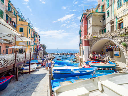 Riomaggiore, Italy - Jun 17, 2018: Ancient village in Cinque Terre, Italy in the province of La Spezia, situated in a small valley in the Liguria region of Italy.