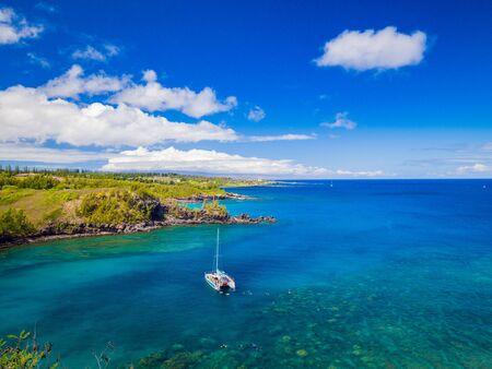 Landscape of Honolua Bay in Maui Hawaii. Honolua Bay located north of Kapalua, West Maui Hawaii, United States. Snorkeling paradise coral reefs in marine preserve. 写真素材