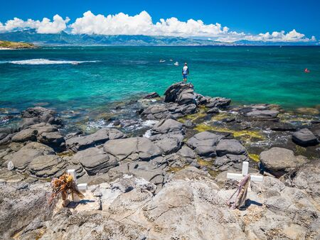 Ho'okipa Beach Park in Maui Hawaii, renowned windsurfing and surf site for wind, big waves and big Turtles drying on sand. Snorkeling paradise for coral reefs.