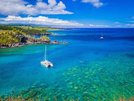 Landscape of Honolua Bay in Maui Hawaii. Honolua Bay located north of Kapalua, West Maui Hawaii, United States. Snorkeling paradise coral reefs in marine preserve.