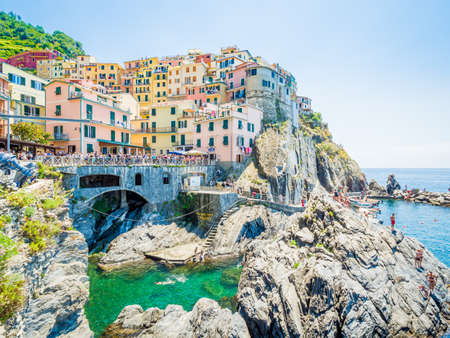 Manarola, Italy - Jun 17, 2018: Ancient village in Cinque Terre, Italy in the province of La Spezia, situated in a small valley in the Liguria region of Italy