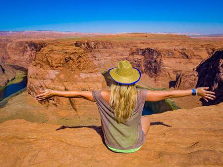 Sexy girl admires panorama of Horseshoe Bend, Page Arizona