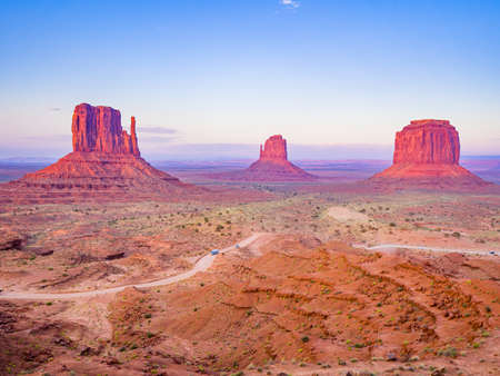 Sunset on Monument Valley from Visitor Center, region of Colorado Plateau characterized by cluster of vast sandstone buttes, Arizona Utah border