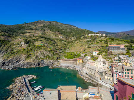 View of Vernazza one of five famous colorful villages of Cinque Terre National Park in Italy, suspended between sea and land on sheer cliffs