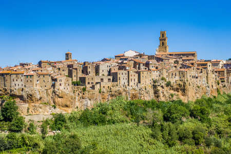 Pitigliano, Tuscany perched on tuff cliff, Old Town and alleys. Splendid town in the Tufo Area, in the heart of Tuscan Maremma, Pitigliano perched on tuff cliff one of most beautiful villages in Italy