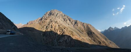 Alpine auto road in Andes under contrast evening light, Chile Stock Photo