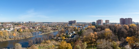 Birds eye view of the Russian small riverside town in autumn, Moscow District, Russia