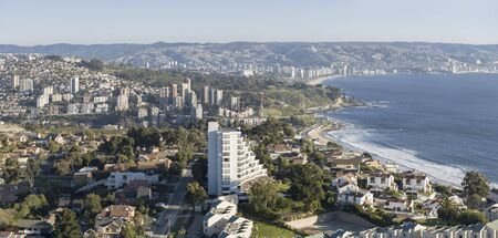 Birds eye view of seaside city late in the day, Renaca, Chile Stock Photo