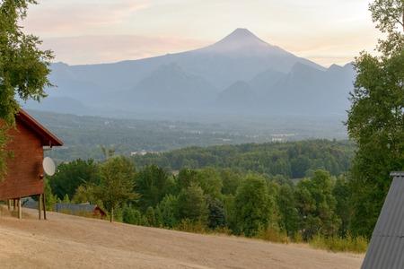 Dimming purple sunset over the Villarrica volcano at summer evening