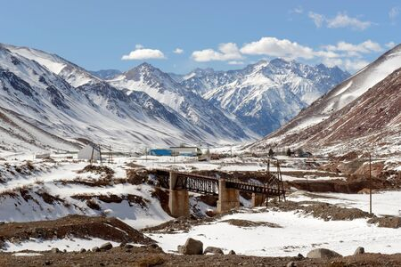 Railroad bridge in snow-covered mountains