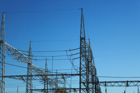 electric substation against the sky High-voltage electrical insulator electric line