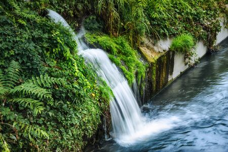 hand made small waterfall on canal Stockfoto