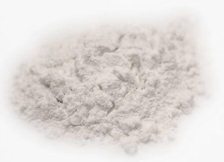 Heap of flour on white background Stockfoto
