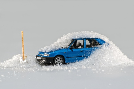 snowbank: Automobile model buried in snow