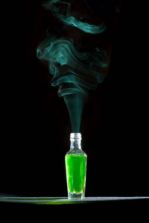 Genio dalla bottiglia. Isolato su bianco. Archivio Fotografico - 10859567