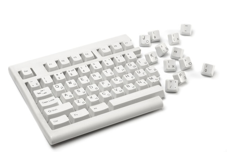 reducing: One half of a broken keyboard with keys near isolated on white
