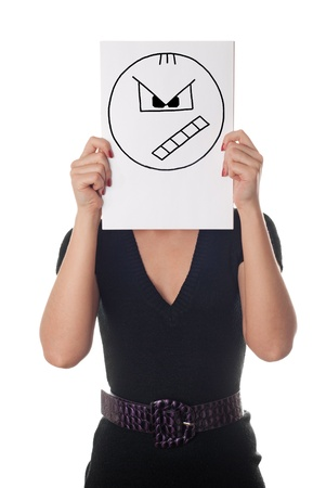 incensed: Young woman with the painted angry smile on the sheet of paper over his face isolated on white