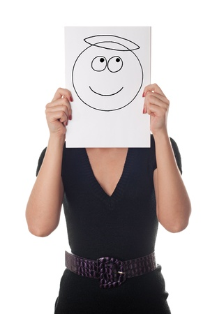 good humor: Young woman with the painted smile with nimbus on the sheet of paper over his face isolated on white Stock Photo