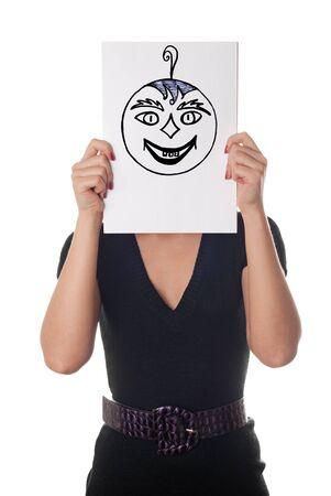 Giovane donna con il sorriso dipinto felice e pazzo sul foglio di carta sul viso isolato su bianco Archivio Fotografico - 10859594