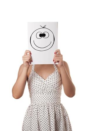 Giovane donna in abito estivo bianco con il foglio di carta bianco sul viso isolato su bianco Archivio Fotografico - 10859582