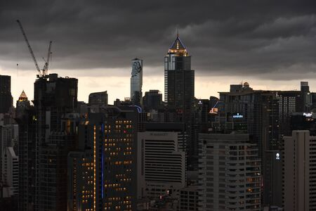 Enigmatic sky of Sea of skyscrapers in Bangkok city center before the rain,