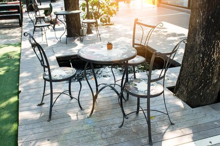 Wooden chairs and table in the garden