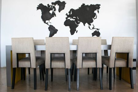 modern dining room interior World map background. Stock fotó