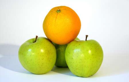Orange Apples stacked with white background Standard-Bild