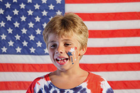 Boy in-front of the American Flag Standard-Bild