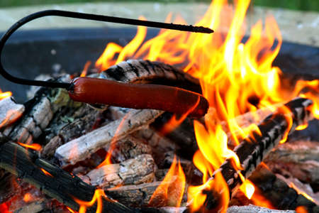 weenie: Hot dog roasting over a fire