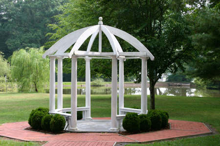 Gazebo in summer with lake view in background