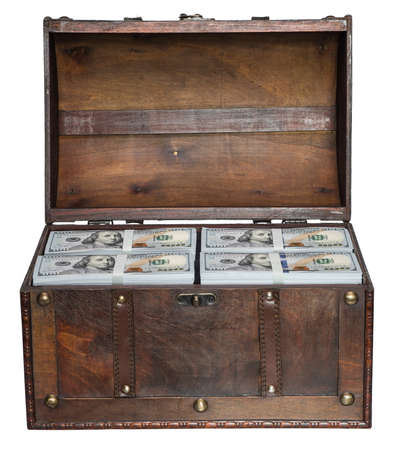 treasure chest: Old open chest filled with stacks of bundles of 100 US dollars isolated on white background.
