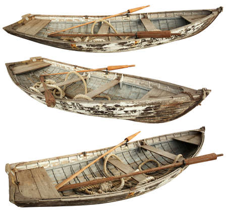 oars: The old boat with oars and a rope inside. Isolated on a white background. Stock Photo