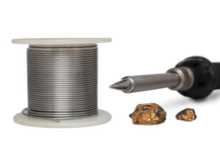 brazing: Tool kit for soldering. Electric soldering iron, solder and rosin isolated on white background.