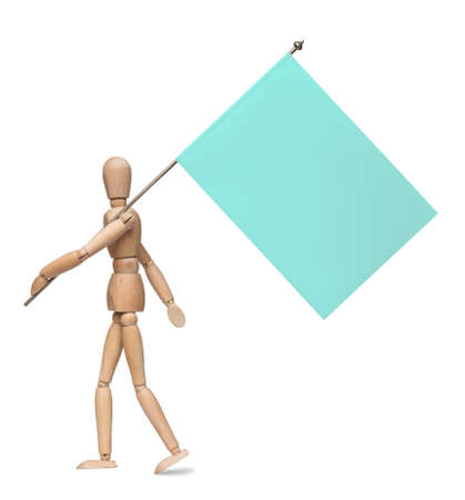 wooden figure: The wooden lay figure marches with a flag on an iron spike. Isolated on the white background. With shadow.