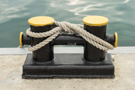 bollard: Bollard on a wharf. Ships rope may be secured to bollard.