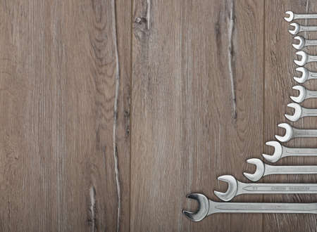 crescent wrench: Set of wrenches. Wrenches of several sizes on a wooden background.