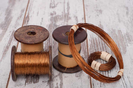 ebonite: Set of copper wires. Copper wire on the spools and rolls on the old planks.