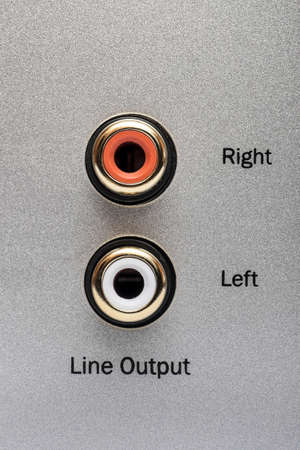output: Sockets of the line output on an aluminum panel. It is a part of the rear panel of CD or DVD player.