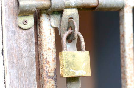 old rusted lock on a door photo